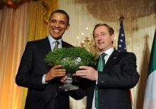 Taoiseach Enda Kenny gives US President Barack Obama a bowl of shamrock during a St. Patrick's Day reception in the East Room of the White House, on Thursday, March 17, 2011, during his visit to Washington, DC.  (Photo by Leslie E. Kossoff/LK Photos)